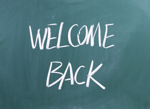 Welcome Back written on a blackboard as a concept for hospitality or Customer Focus in business